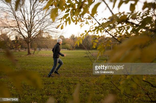 In this photo illustration a man is running on gras on November 04, 2020 in Bonn, Germany.