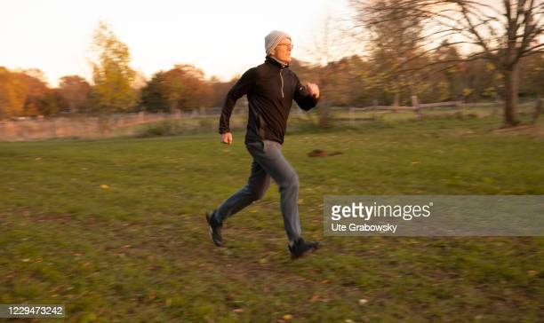 In this photo illustration a man is running on November 04, 2020 in Bonn, Germany.