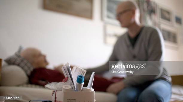 In this photo illustration a man is sitting at an old person's bedside on February 14 2020 in Heidelberg Germany