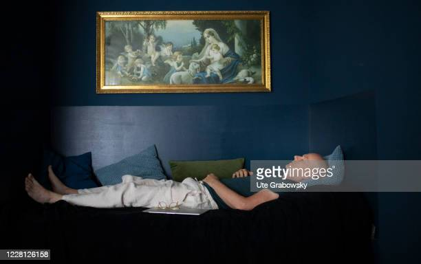 In this photo illustration a man is sleeping or relaxing on a couch on August 19 2020 in Bonn Germany