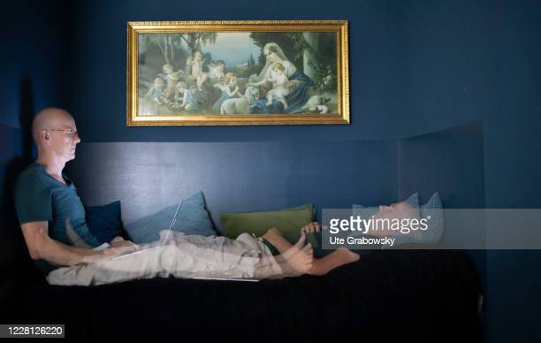 In this photo illustration a man is working and sleeping at home on August 19 2020 in Bonn Germany