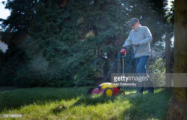 In this photo illustration a man is working in a garden on March 06, 2021 in Bonn, Germany.