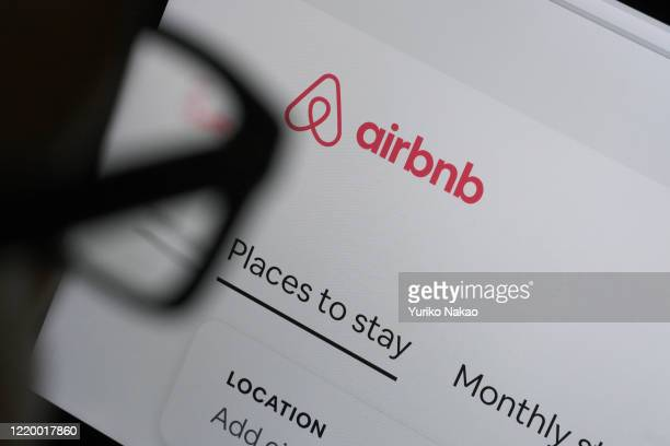 In this photo illustration a man looks at the website of Airbnb on April 20 2020 in Katwijk Netherlands