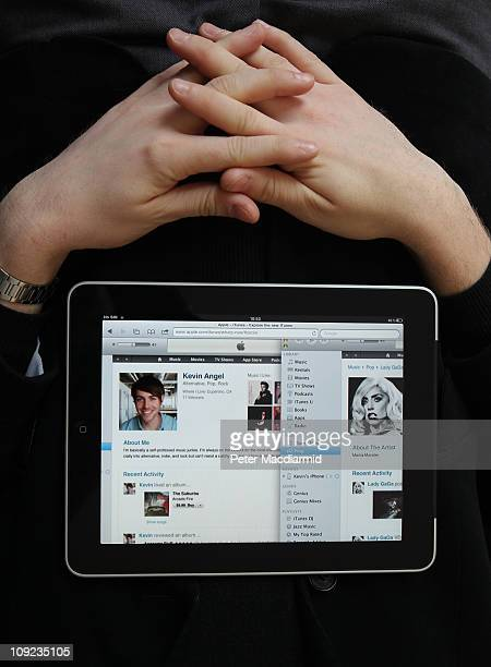 In this photo illustration a man rests with an Apple ipad tablet on February 17 2011 in London England Apple sold two million ipads in the first two...