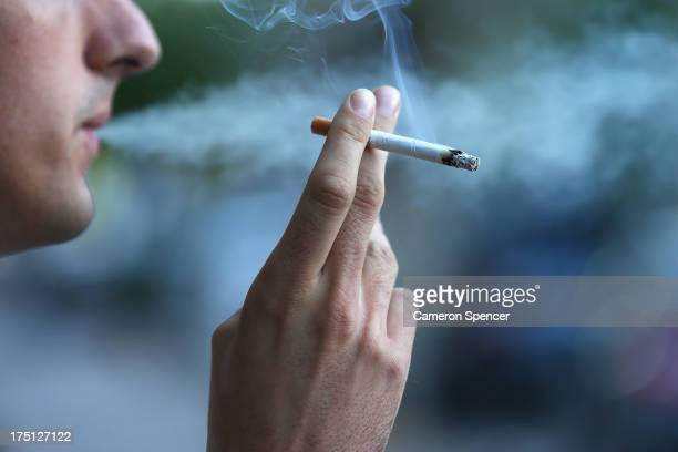 In this photo illustration a man smokes on August 1 2013 in Sydney Australia In a plan announced today the government will increase the excise on...