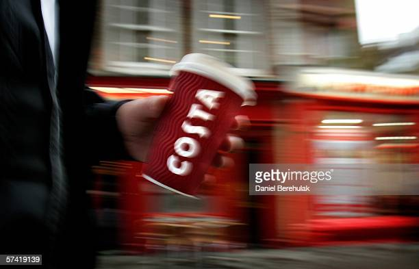 In this photo illustration a man walks past a Costa Coffee Store in central London on April 25 2006 in London England The all traditional English...