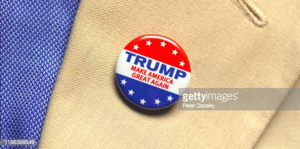 In this photo illustration, a man wears a campaign button badge promoting Donald Trump as President shot on August 6,2019 in London.