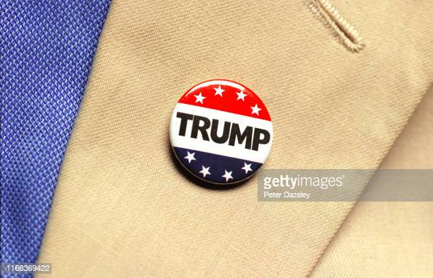 In this photo illustration a man wears a campaign button badge promoting Donald Trump as President shot on August 62019 in London