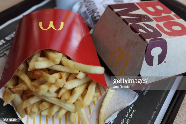 In this photo illustration, a McDonald's Big Mac, double hamburger and french fries are seen on a tray on April 30, 2018 in Miami, Florida. The...