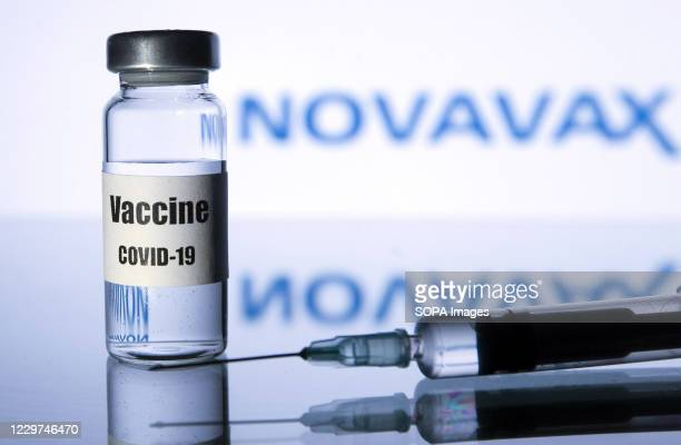 in-this-photo-illustration-a-medical-syringe-and-a-vial-with-covid19-picture-id1229746470?s=612x612&profile=RESIZE_400x