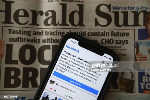 In this photo illustration a message is seen on Facebook mobile, on February 18, 2021 in Melbourne, Australia. Facebook has banned publishers and...