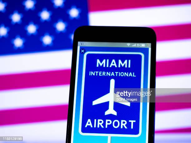 In this photo illustration a Miami International Airport logo seen displayed on a smartphone