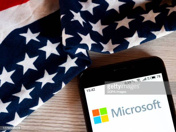 In this photo illustration a Microsoft logo is seen displayed on a smartphone.