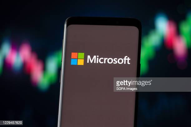 In this photo illustration a Microsoft logo seen displayed on a smartphone.