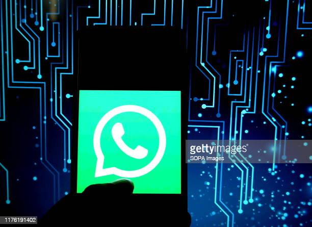 In this photo illustration a mobile messaging application whatsapp displayed on a smartphone