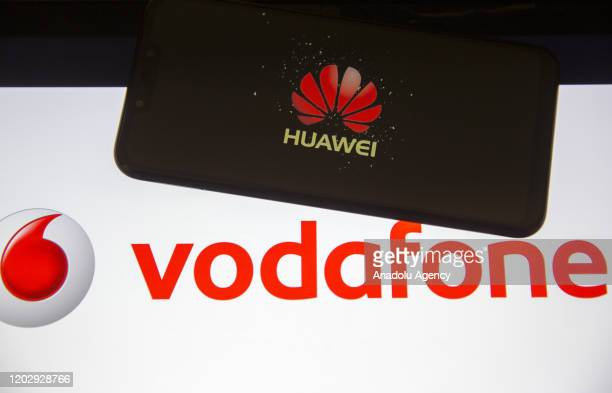 In this photo illustration a mobile phone screen displays Huawei logo in front of a computer screen displaying Vodafone logo in Ankara Turkey on...