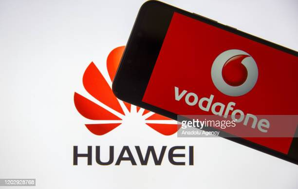 In this photo illustration a mobile phone screen displays Vodafone logo in front of a computer screen displaying Huawei logo in Ankara Turkey on...
