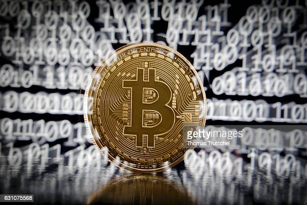 In this photo illustration a model Bitcoin stands in front of a binary code on January 06 2017 in Berlin Germany Shooting with slow shutter and zoom...