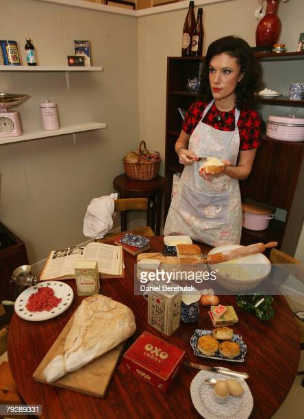 In this photo illustration a model butters a piece of bread in a set up 1950's room during the release of the annual Family Spending report on...
