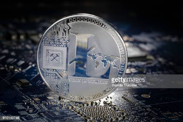 In this photo illustration a model coin of the cryptocurrency Litecoin stand on a circuit board of a computer on January 25 2018 in Berlin Germany