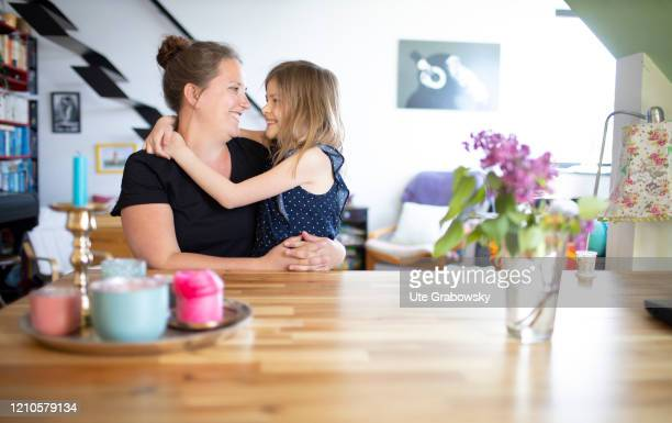 In this photo illustration a mother and a seven year old girl are looking at each other on April 15 2020 in Bonn Germany