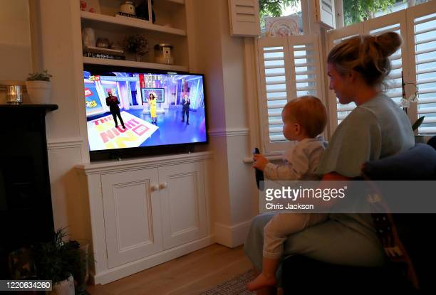 In this photo illustration a mother and child known to the photographer watch the BBC Children In Need and Comic Relief 'Big Night In at London on...