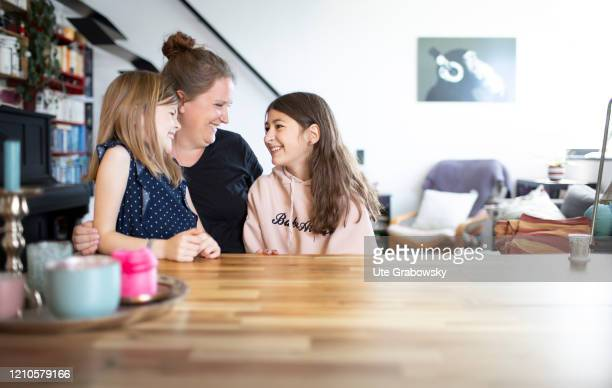 In this photo illustration a mother and her children are looking at each others on April 15 2020 in Bonn Germany