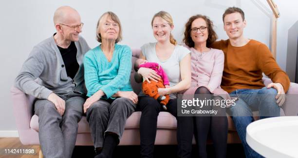 In this photo illustration a Mother Father Grandmother Grandfather and a greatgrandmother and a baby sitting on a sofa on March 15 2019 in Bonn...