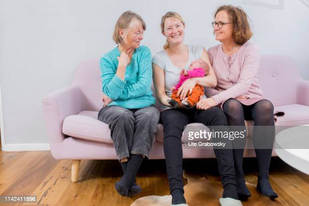 In this photo illustration a Mother Grandmother and greatgrandmother and a baby sitting on a sofa on March 15 2019 in Bonn Germany
