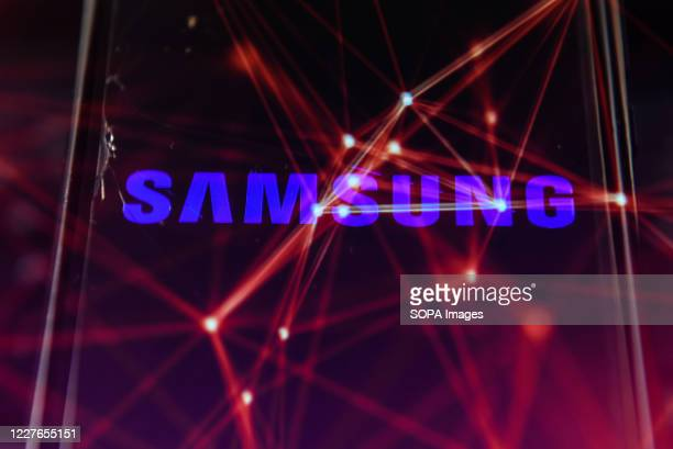 In this photo illustration a multiple exposure image shows a Samsung logo displayed on a smartphone with stock market percentages on the background.