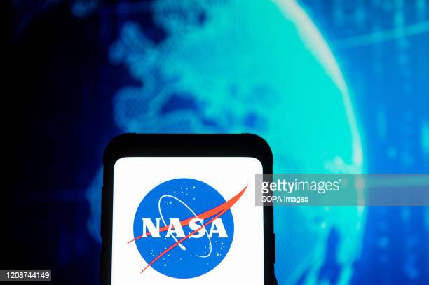 In this photo illustration a NASA logo seen displayed on a smartphone.