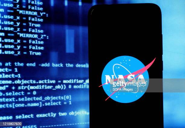 In this photo illustration a NASA logo seen displayed on a smartphone Nasa Spacex have postponed their lunch attempt of the Demo2 test flight to the...