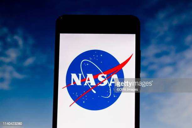 In this photo illustration a National Aeronautics and Space Administration or NASA logo seen displayed on a smartphone.