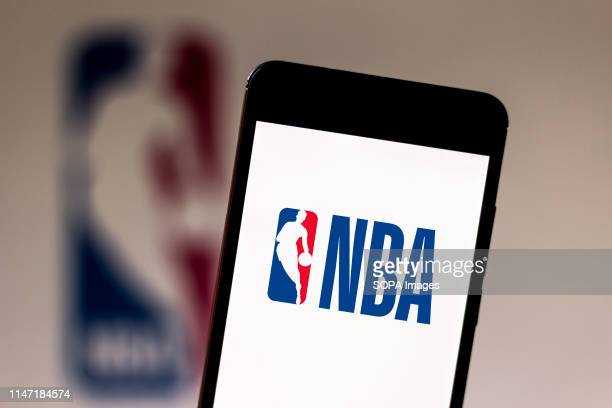 In this photo illustration a National Basketball Association logo seen displayed on a smartphone