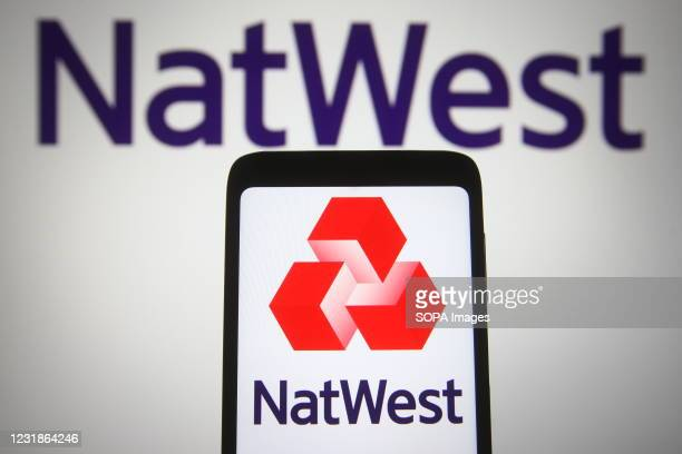 In this photo illustration a National Westminster Bank logo is seen on a smartphone and a pc screen.