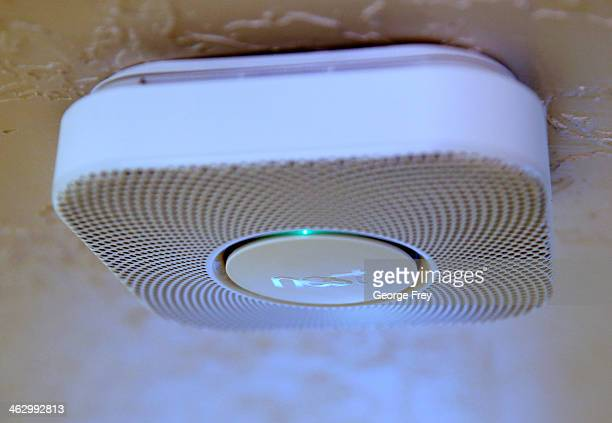 In this photo illustration a Nest smoke and carbon monoxide detector installed in a home is seen on January 16 2014 in Provo Utah Google bought Nest...
