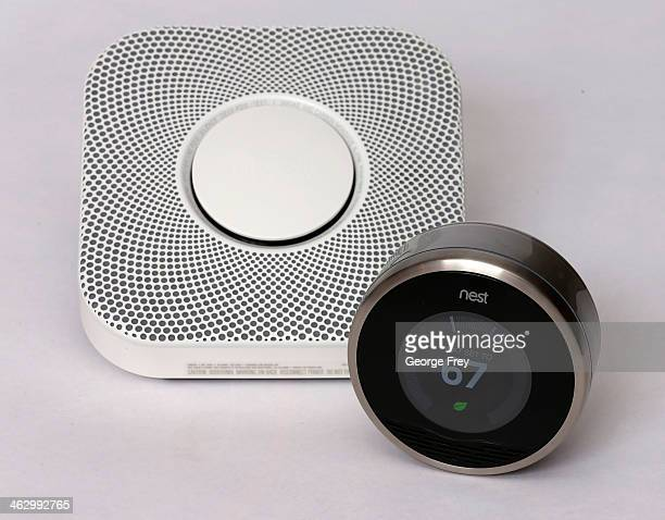 In this photo illustration a Nest thermostat and a smoke/carbon monoxide detector is seen on January 16 2014 in Provo Utah Google bought Nest a home...