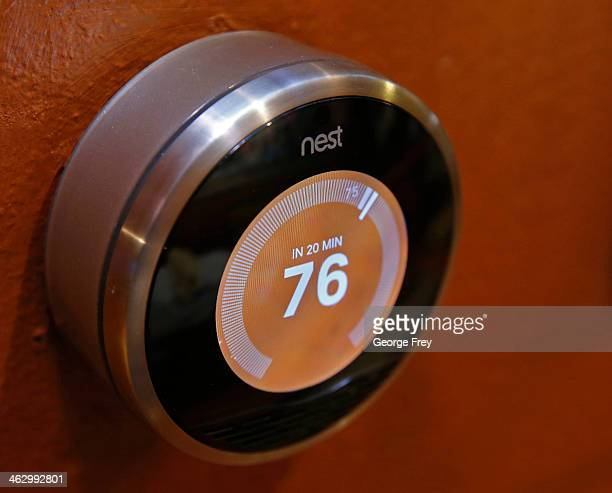 In this photo illustration a Nest thermostat installed in a home is seen on January 16 2014 in Provo Utah Google bought Nest a home automation...