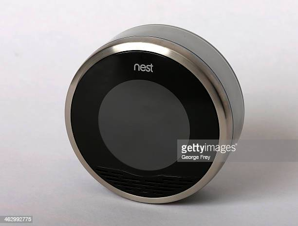 In this photo illustration a Nest thermostat is seen on January 16 2014 in Provo Utah Google bought Nest a home automation company for $32 billion...