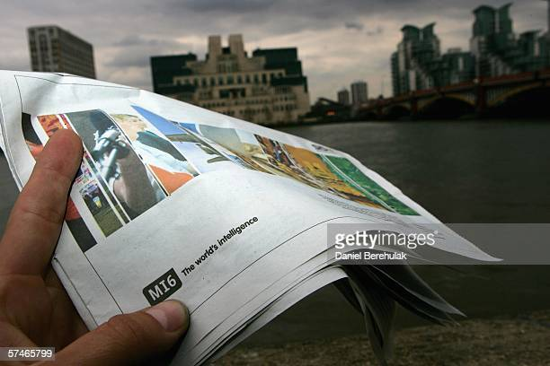 In this photo illustration a newspaper shows an advertisement seeking new MI6 employees as the MI6 headquarters stands in the backround on April 27...