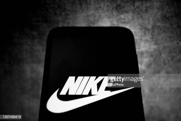 This image has been converted to black and white.) In this photo illustration a Nike logo is displayed on a smartphone on March 16, 2020 in Athens,...