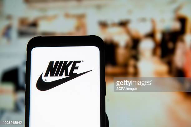 In this photo illustration a Nike logo seen displayed on a smartphone.