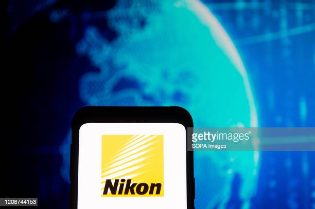 In this photo illustration a Nikon logo seen displayed on a smartphone.