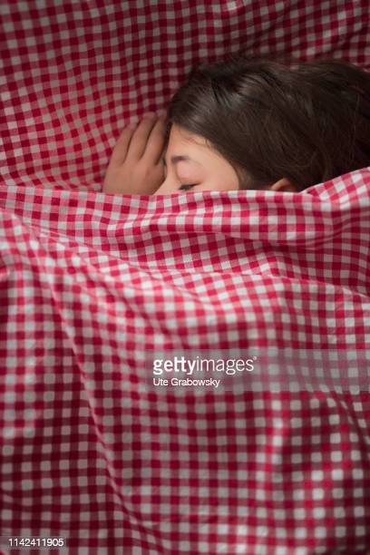 In this photo illustration a nine years old girl is sleeping in checkered bed linen on April 07 2019 in Bonn Germany