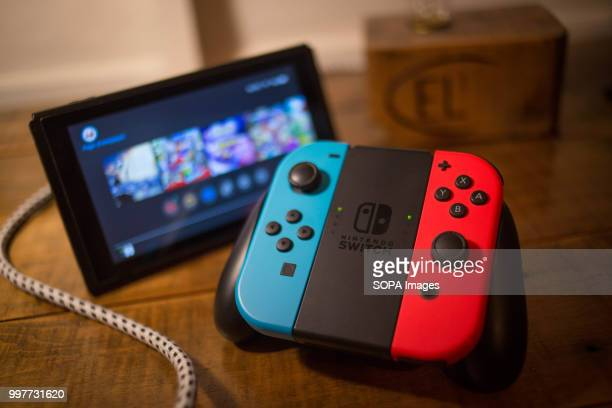 In this photo illustration, a Nintendo Switch seen with the main controller.