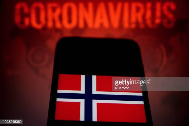 In this photo illustration a Norway flag is displayed on a smartphone with background a Coronavirus picture on March 25, 2020 in Athens, Greece.