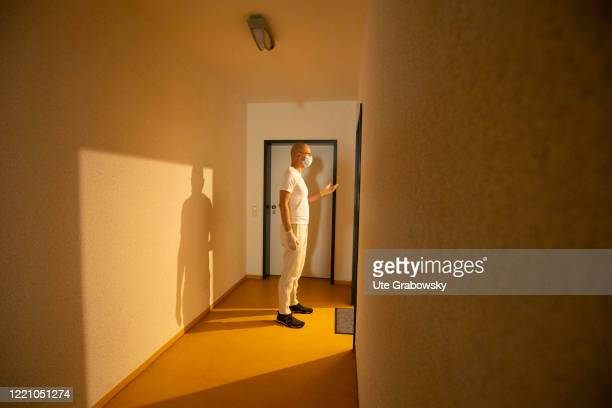 In this photo illustration a nurse is standing at a on a patient's doorstep on June 11, 2020 in Bonn, Germany.