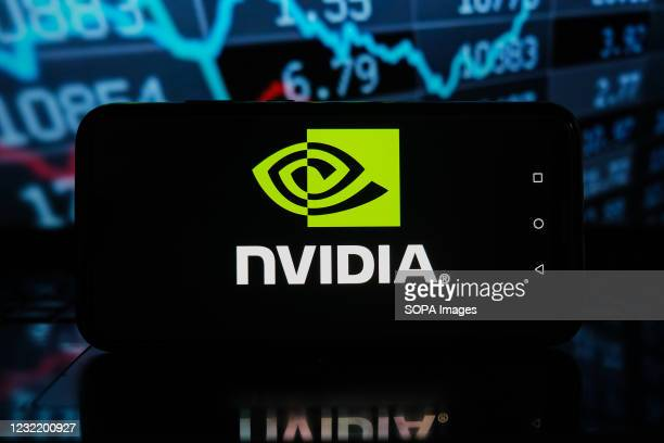 In this photo illustration a Nvidia logo seen displayed on a smartphone with stock market percentages in the background.