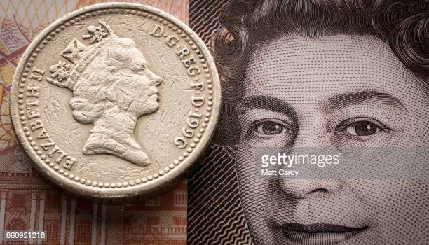 In this photo illustration a old £1 coin is seen on top of a new £10 note on October 13 2017 in Bristol England The deadline to use the old one pound...