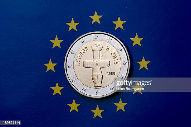 In this photo illustration a one Euro 2008 coin from the Republic of Cyprus is displayed on the flag of Europe the emblem of the European Union on...